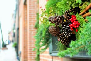 Image of a holiday garland on the side of a brick building